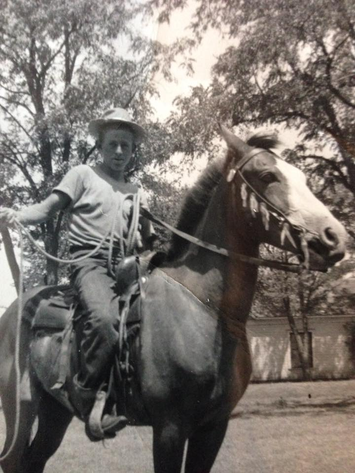 Dad  young on a horse.