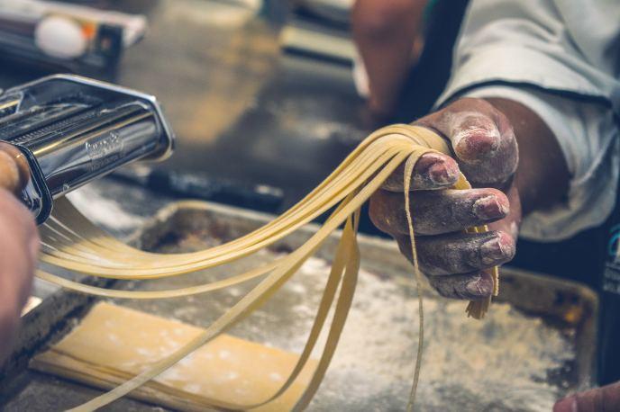 pasta hand photo-1447279506476-3faec8071eee.jpg